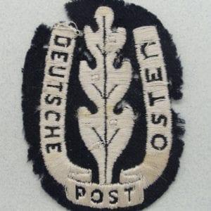 """""""DEUTSCHE POST OSTEN"""" Postal Sleeve Shield"""
