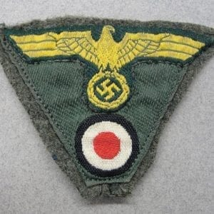 Kriegsmarine Coastal Artillery Cap Insignia on Piece of Cap